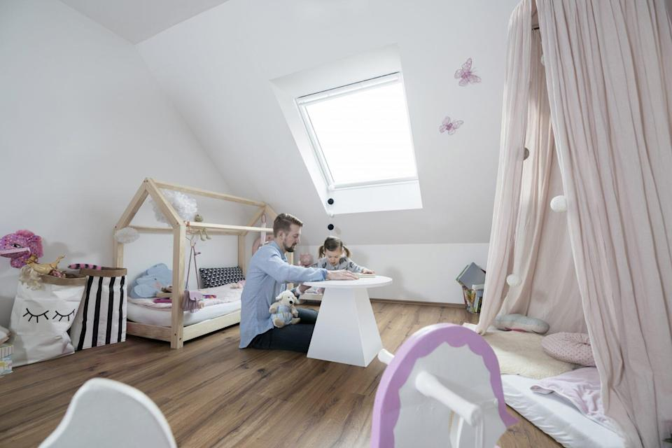 Father and daughter in her nursery