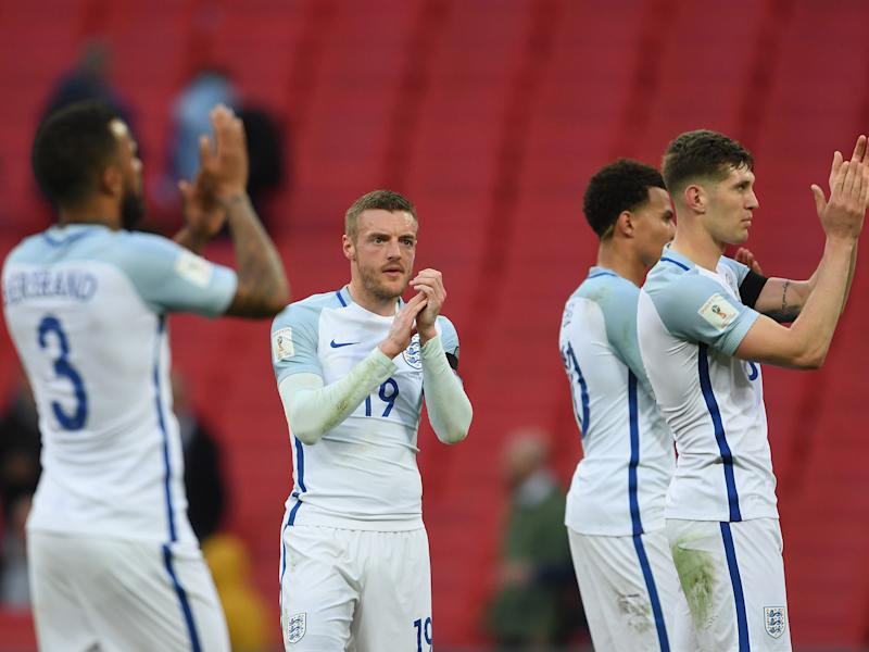 England's players applaud after the final whistle: Getty