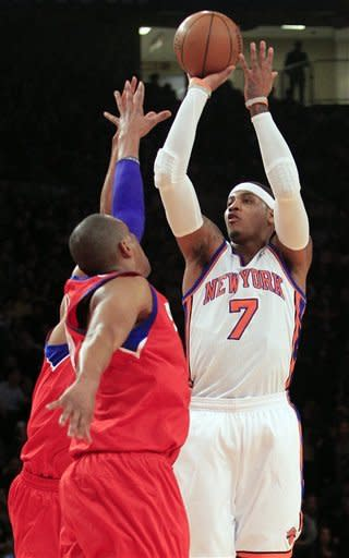 New York Knicks' Carmelo Anthony (7) shoots over Philadelphia 76ers' Tony Battie during the first half of an NBA basketball game, Wednesday, Jan. 11, 2012, in New York. (AP Photo/Frank Franklin II)