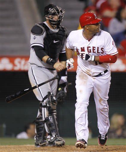 Los Angeles Angels' Vernon Wells watches his two-run home run, as Chicago White Sox catcher A.J. Pierzynski looks away during the sixth inning of a baseball game in Anaheim, Calif., Wednesday, May 16, 2012. (AP Photo/Chris Carlson)