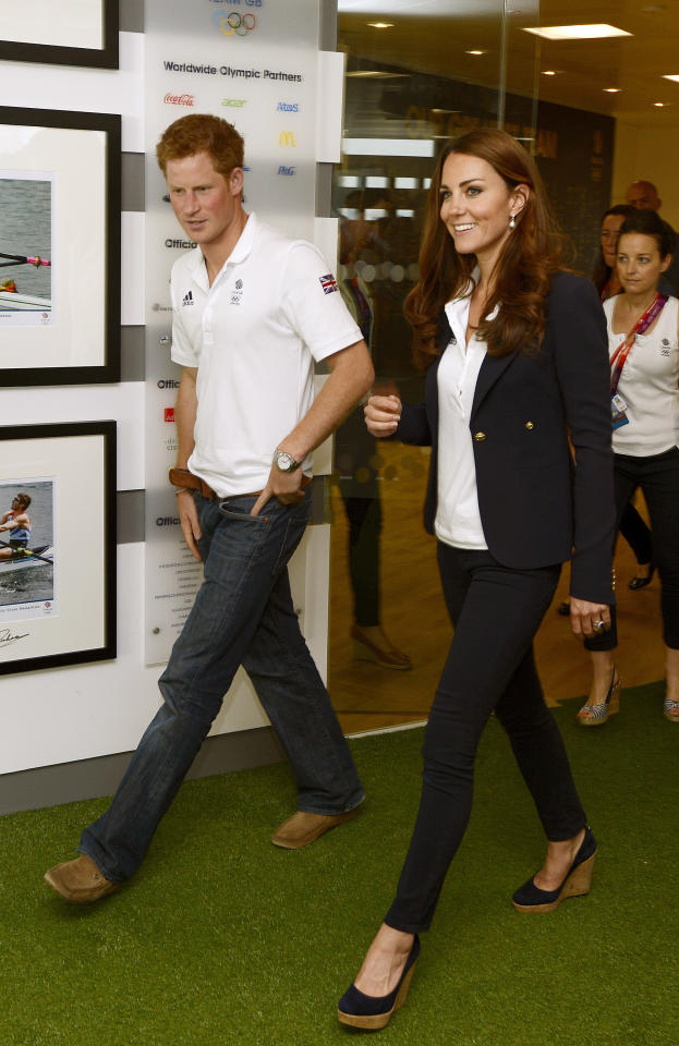 LONDON, UNITED KINGDOM - AUGUST 9:  Prince Harry and Catherine, Duchess of Cambridge visit athletes at Team GB House in the Westfield Centre on Day 13 of the London 2012 Olympic Games on August 9, 2012 in London, England.  (Photo by John Stillwell - WPA Pool/Getty Images)