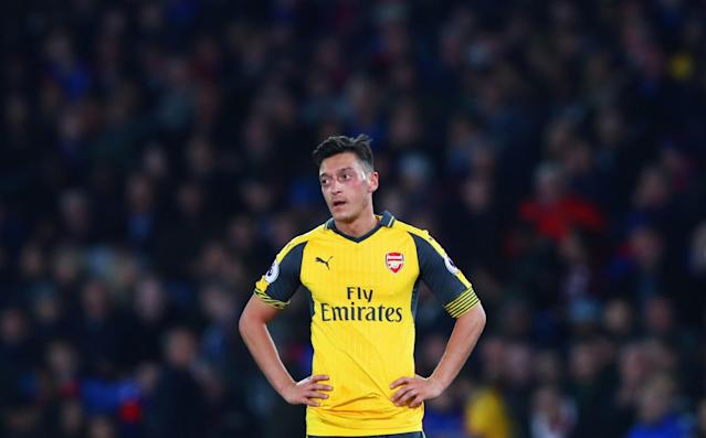 <p>Mesut Ozil of Arsenal looks dejected</p>