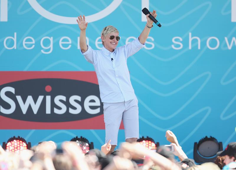 MELBOURNE, AUSTRALIA - MARCH 26: Television personality Ellen DeGeneres dances on stage during the filming of her television show at Birrarung Marr on March 26, 2013 in Melbourne, Australia. DeGeneres is in Australia to film segments for her TV show, 'Ellen'. (Photo by Scott Barbour/Getty Images)
