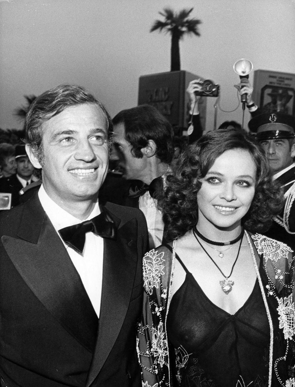"""FILE - In this June 16, 1974 file photo, French actor Jean-Paul Belmondo and actress Laura Antonelli of Italy arrive at Festival House for presentation of film """" Stavisky"""", on June 16, 1974. French New Wave actor Jean-Paul Belmondo has died, according to his lawyer's office on Monday Sept. 6, 2021. (AP Photo/Levy, File)"""