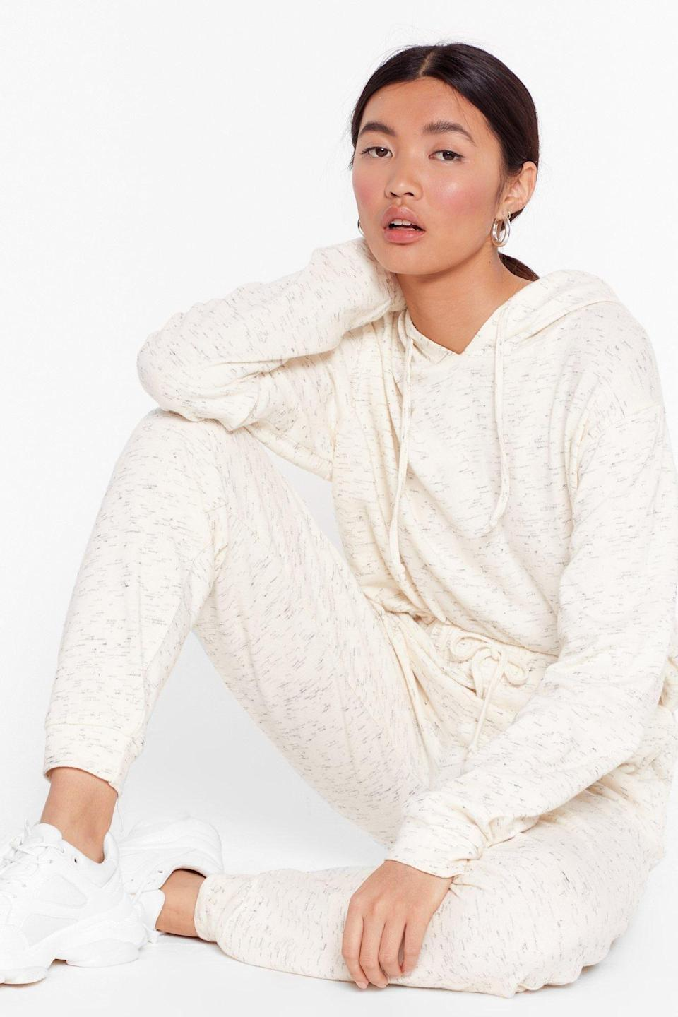 """<p><strong>NastyGal Basics</strong></p><p>nastygal.com</p><p><strong>$40.00</strong></p><p><a href=""""https://go.redirectingat.com?id=74968X1596630&url=https%3A%2F%2Fwww.nastygal.com%2Fca%2Frunning-late-hoodie-and-joggers-set%2FAGG56531.html&sref=https%3A%2F%2Fwww.goodhousekeeping.com%2Fclothing%2Fg35044369%2Fbest-matching-sweatsuits-women%2F"""" rel=""""nofollow noopener"""" target=""""_blank"""" data-ylk=""""slk:Shop Now"""" class=""""link rapid-noclick-resp"""">Shop Now</a></p><p>The top features a drawstring hood and drop sleeves, and the joggers fit high-waisted and cuff at the ankles. Made of 95% polyester and 5% elastane, the material is <strong>lightweight and soft</strong>. Both pieces are sold together as a set. </p>"""