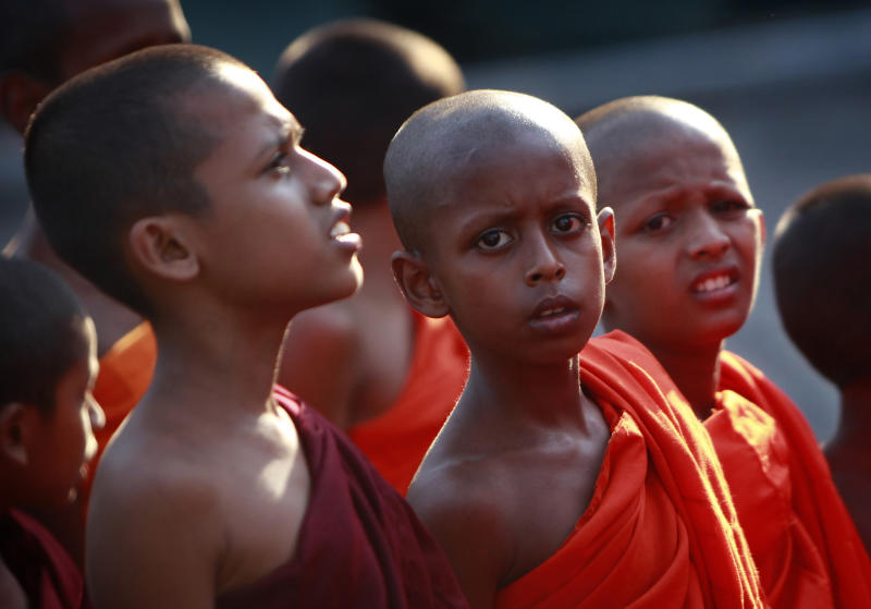Young Buddhist monks walk during a street march ahead of a prayer session, denouncing the proposed U.N. Human Rights Council resolution on alleged rights abuses during the country's civil war, in Colombo, Sri Lanka, Monday, March 19, 2012. Hundreds of Buddhist, Hindu, Muslim and Christian clergy representing the main religions of Sri Lanka took part in a ceremony to pray for the defeat of a United States-backed resolution urging the country to investigate allegations of war crimes in the final stages of the country's civil war. The resolution is expected to be put to voting at the United Nations Human Rights Council sessions in Geneva this week. (AP Photo/ Gemunu Amarasinghe)