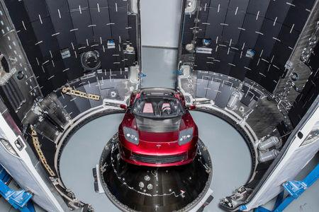 A red Tesla Roadster is seen during preparations to use it as a mock payload for the launch of a SpaceX Falcon Heavy rocket