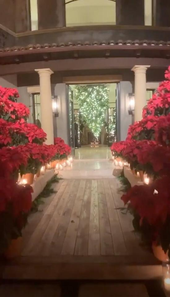 """Let's start with the decor! It was <a href=""""https://people.com/tv/kourtney-kardashian-seems-very-happy-spending-time-younes-bendjima-source/"""">Kourtney Kardashian</a>'s turn to host the annual Kardashian-Jenner Christmas (or should we say<em>Krismas</em>) Eve bash, and the eldest Kardashian sister did not disappoint."""