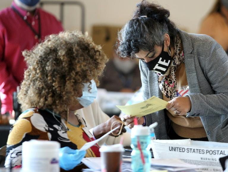 Election workers examine ballots while vote counting in Atlanta, Georgia
