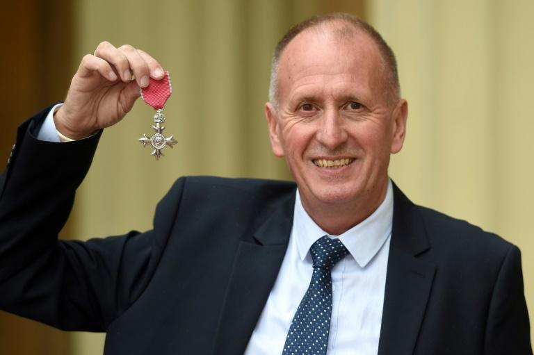 British rescue diver Vernon Unsworth poses with his medal after being appointed a Member of the Order of the British Empire (MBE) during an investiture ceremony at Buckingham Palace in London on June 12, 2019