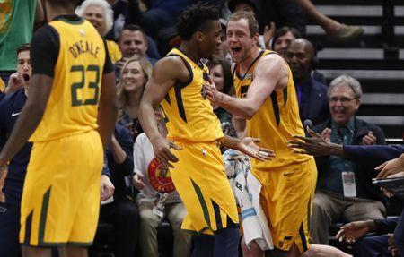 Apr 5, 2018; Salt Lake City, UT, USA; Utah Jazz forward Joe Ingles (2) reacts to guard Donovan Mitchell (45) after a basket and foul in the first quarter against the LA Clippers at Vivint Smart Home Arena. Mandatory Credit: Jeff Swinger-USA TODAY Sports