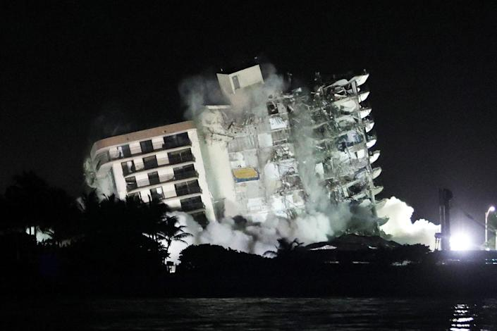The remaining part of the partially collapsed 12-story Champlain Towers South condo building falls with a controlled demolition on July 4, 2021, in Surfside, Fla. (Joe Raedle / Getty Images)