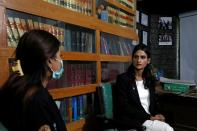 Nisha Rao, 28, a transgender woman who became country's first practicing lawyer, listens to one of her clients at office in Karachi,