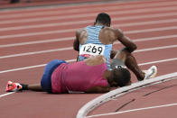 Isaiah Jewett, of the United States, and Nijel Amos, background, of Botswana, fall in the men's 800-meter semifinal at the 2020 Summer Olympics, Sunday, Aug. 1, 2021, in Tokyo. (AP Photo/Jae C. Hong)