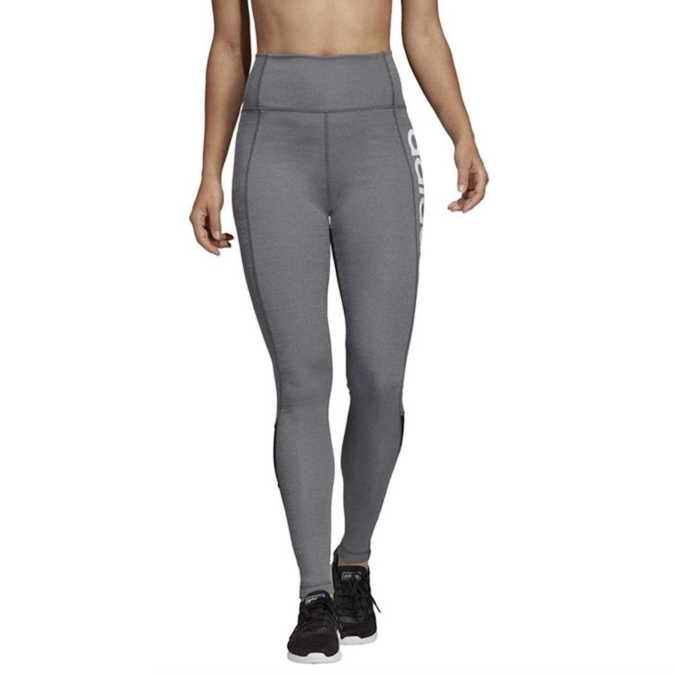 """These high-rise leggings have mesh panels and sweat-wicking technology that will keep you cool during the sweatiest hot yoga sessions, so add them to cart while you count down the days until your studio reopens. $50, Amazon. <a href=""""https://www.amazon.com/adidas-Designed-Tights-Heather-Large/dp/B07DWQK2K4/ref=sr_1_19_sspa?th=1&psc=1"""" rel=""""nofollow noopener"""" target=""""_blank"""" data-ylk=""""slk:Get it now!"""" class=""""link rapid-noclick-resp"""">Get it now!</a>"""