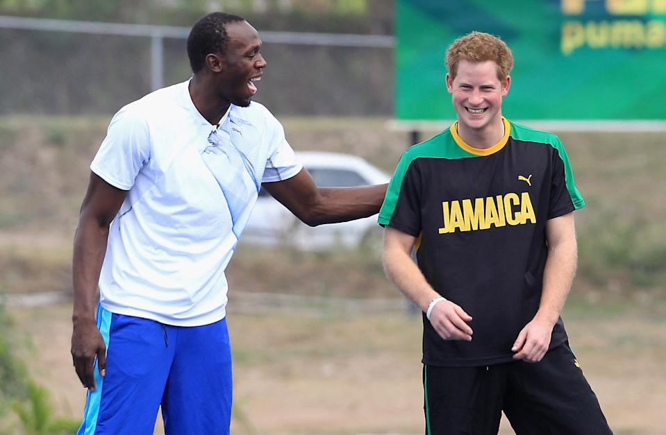 Prince Harry raced Usain Bolt at the University of the West Indies in March 2012 in Kingston, Jamaica, during an extensive tour. The pair looked like they enjoyed hanging out. (Chris Jackson/Getty Images)