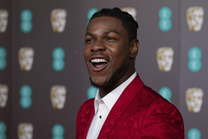 John Boyega poses for photographers upon arrival at the Bafta Film Awards, in central London, Sunday, Feb. 2 2020. (Photo by Vianney Le Caer/Invision/AP)
