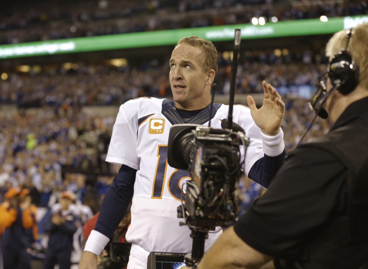 Denver Broncos quarterback Peyton Manning (18) waves to the fans before an NFL football game against the Indianapolis Colts, Sunday, Oct. 20, 2013, in Indianapolis. (AP Photo/Michael Conroy)