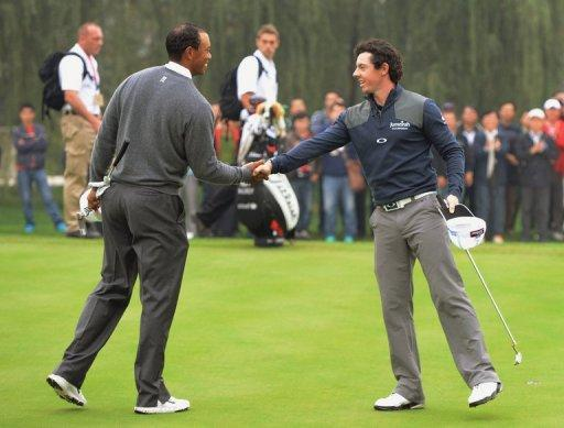 Tiger Woods of the US (L) shakes hands with Rory McIlroy of Northern Ireland in October