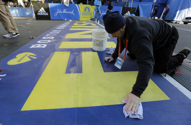 Anthony Bisenti cleans the finish line before the running of the 118th Boston Marathon Monday, April 21, 2014 in Boston. (AP Photo/Robert F. Bukaty)