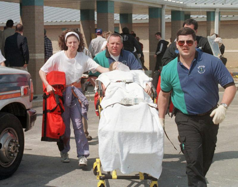 Emergency personnel rush an unidentified student to an ambulance at Westside Middle School