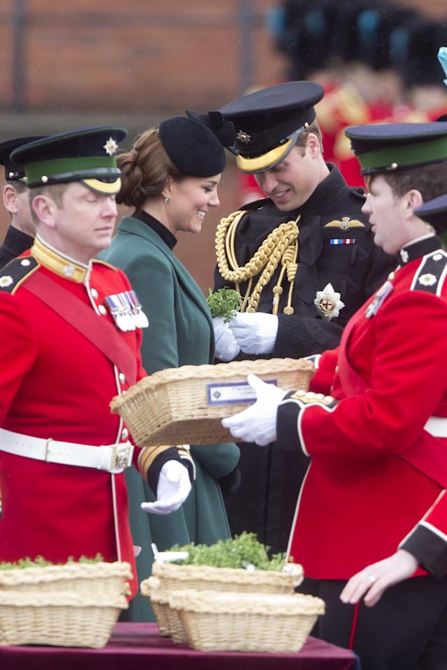 ALDERSHOT, ENGLAND - MARCH 17:  Catherine, Duchess of Cambridge and Prince William, Duke of Cambridge attend The Irish Guards St Patricks Day Parade, at Mons Barracks, where The Duchess presented the traditional sprigs of shamrock, on March 17, 2013 in Aldershot, England.  (Photo by Julian Parker/UK Press via Getty Images)