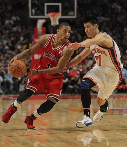 Derrick Rose of the Chicago Bulls drives past Jeremy Lin of the New York Knicks at the United Center on March 12, 2012 in Chicago, Illinois. The Bulls defeated the Knicks 104-99