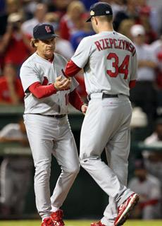 Cardinals manager Tony La Russa takes the ball from Marc Rzepczynski during an eighth-inning pitching change in Game 5 of the World Series