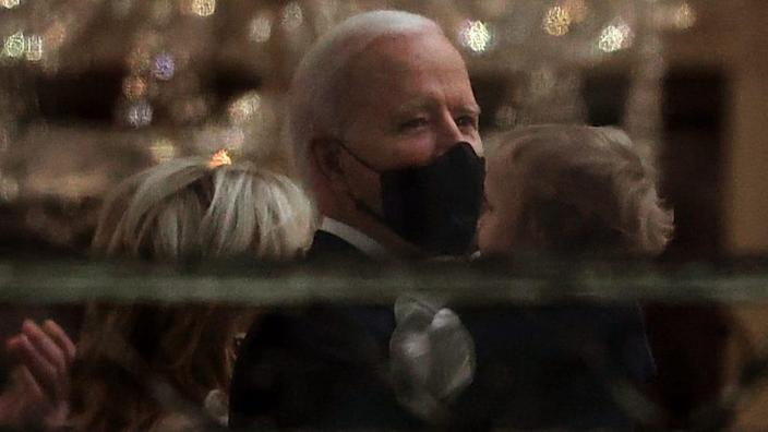 President Joe Biden holds his grandson Beau Biden before watching his inauguration-night fireworks show on the National Mall from the Truman Balcony at the White House Wednesday night. (Photo by Chip Somodevilla/Getty Images)