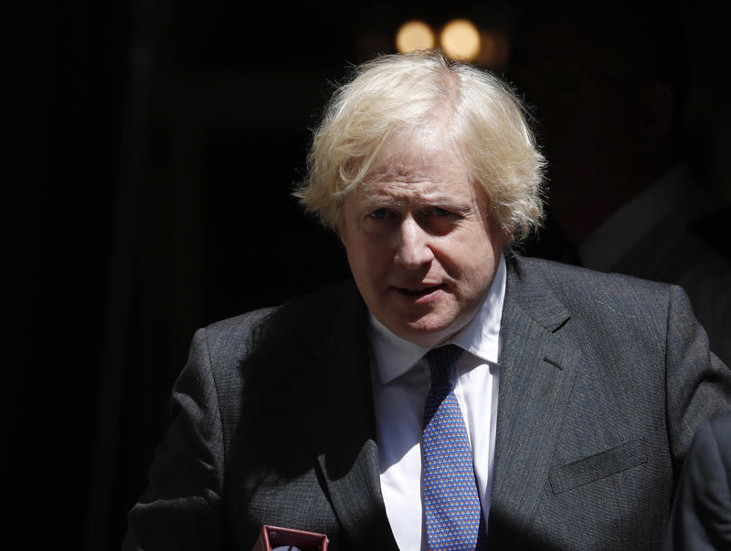 Britain's Prime Minister Boris Johnson leaves 10 Downing Street to attend his weekly Prime Minister Questions at the House of Commons, in London, Wednesday, June 24, 2020. (AP Photo/Alastair Grant)