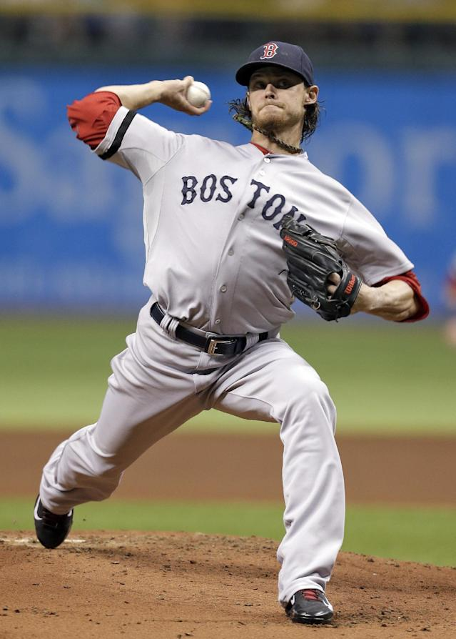 Boston Red Sox starting pitcher Clay Buchholz delivers to Tampa Bay Rays' David DeJesus during the first inning of a baseball game Tuesday, Sept. 10, 2013, in St. Petersburg, Fla. (AP Photo/Chris O'Meara)