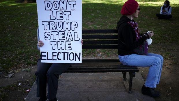 A person holds a placard near the White House after Election Day in Washington, U.S., November 4, 2020.