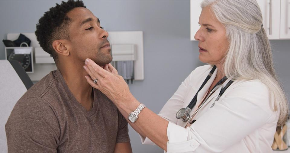 thyroid problems man getting checkup by doctor