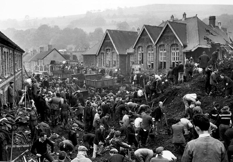 Rescue workers search for victims of the Aberfan disaster, in South Wales, 1966.