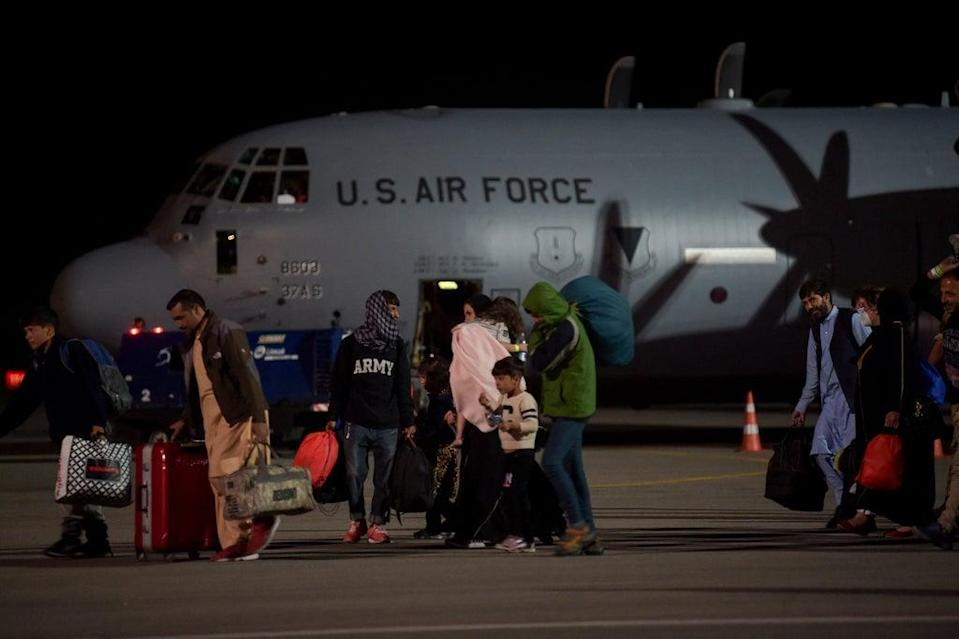 Some refugees boarding planes reportedly do not know where they are heading (AFP via Getty)