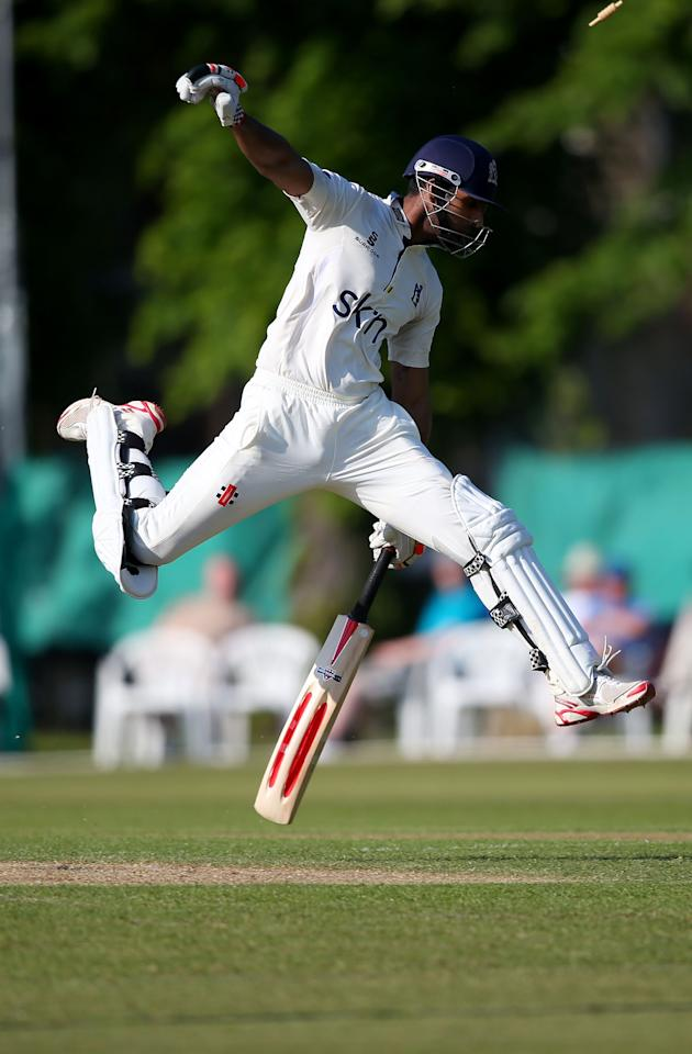 LONDON, ENGLAND - JUNE 05:  Varun Chopra of Warwickshire jumps to avoid being hit by the ball from a run out attempt whilst keeping his ground during day one of the LV County Championship Division One match between Surrey and Warwickshire at Guildford Cricket Club on June 05, 2013 in Guildford, England.  (Photo by Clive Rose/Getty Images)