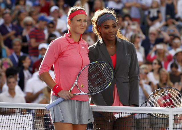 Serena Williams of the U.S. (R) and Victoria Azarenka of Belarus pose ahead of their women's singles final match at the U.S. Open tennis championships in New York September 8, 2013. REUTERS/Adam Hunger (UNITED STATES - Tags: SPORT TENNIS)