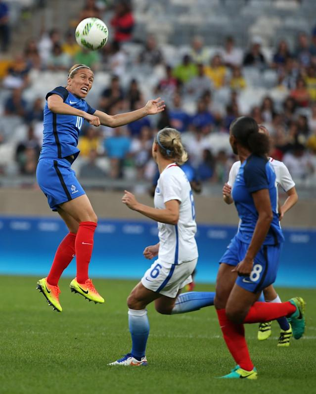<p>France's Camille Abily, left, goes for a header during a group G match of the women's Olympic football tournament between United States and France at the Mineirao stadium in Belo Horizonte, Brazil, Saturday, Aug. 6, 2016. (AP Photo/Eugenio Savio) </p>