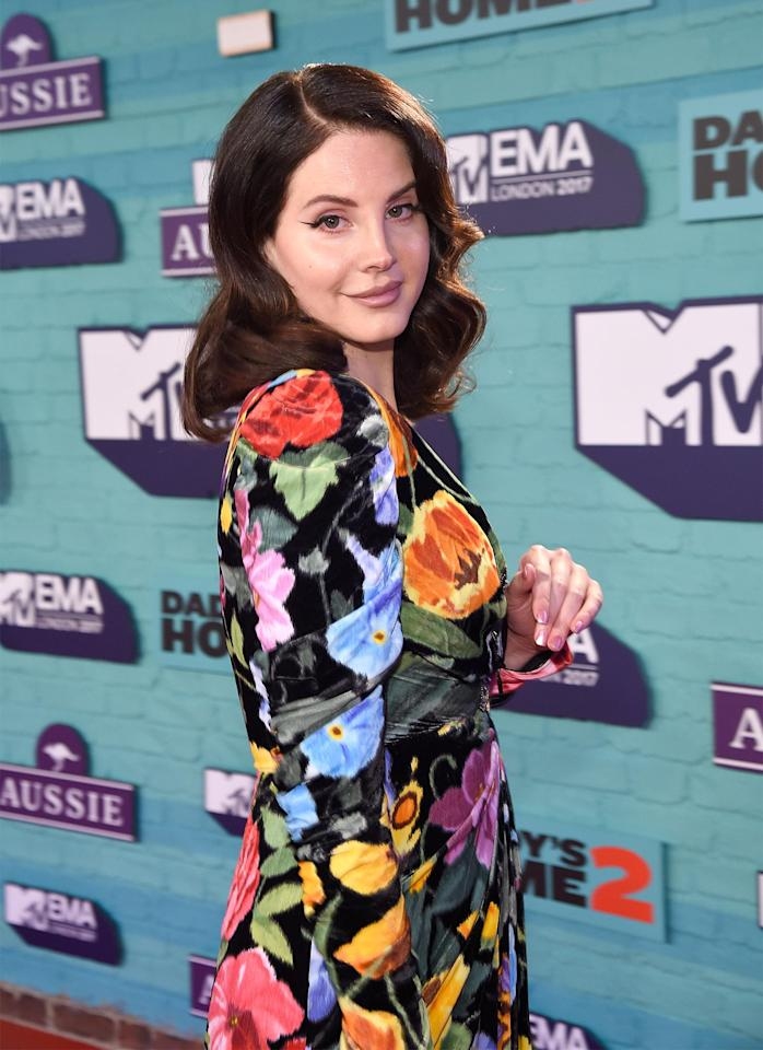 <p>Lana Del Ray kept it classy and feminine with curly hair a simple cat eyeliner.</p>
