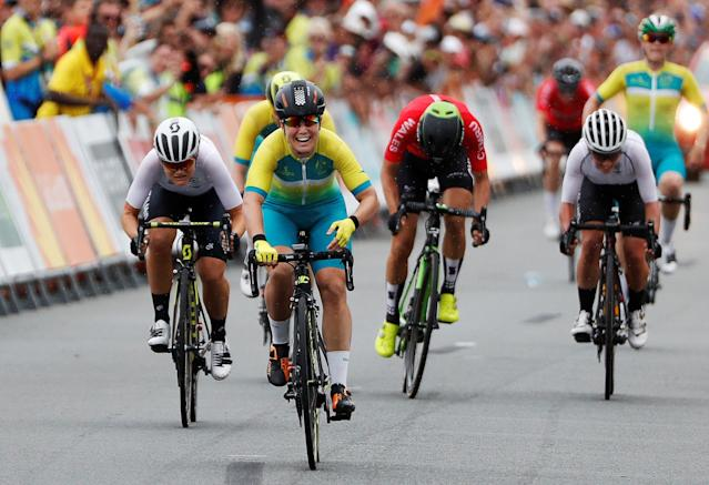 Cycling - Gold Coast 2018 Commonwealth Games - Women's Road Race - Currumbin Beachfront - Gold Coast, Australia - April 14, 2018. Chloe Hosking of Australia crosses the finish line to win the race, with Georgia Williams of New Zealand in second and Danielle Rowe of Wales in third. REUTERS/Paul Childs TPX IMAGES OF THE DAY