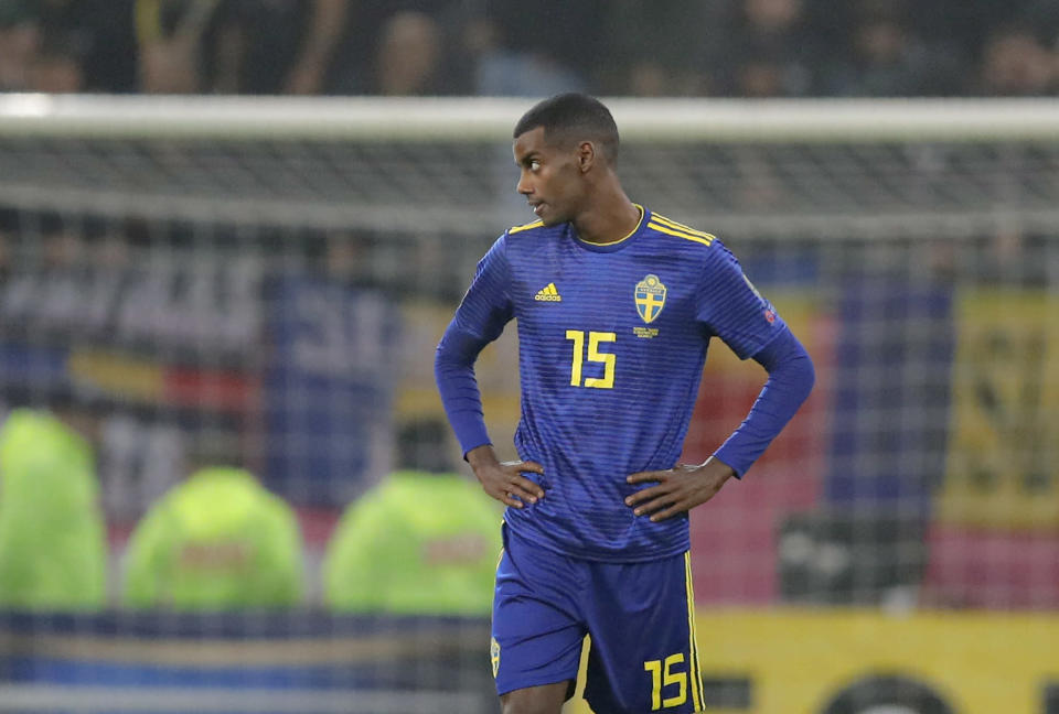 Sweden's Alexander Isak stands on the pitch as the game was briefly halted by referee Daniele Orsato following alleged racist chants against the players during the Euro 2020 group F qualifying soccer match between Romania and Sweden on the National Arena stadium in Bucharest, Romania, Friday, Nov. 15, 2019. (AP Photo/Vadim Ghirda)