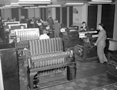 This battery of tabulating machines plays an important part in the gathering of the election returns by the Associated Press in New York, Nov. 3, 1942. The returns, coming in by teletype, are classified and counted with the aid of these and other machines of special design. (AP Photo/Matty Zimmerman)