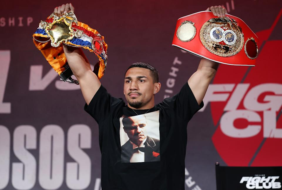 ATLANTA, GEORGIA - APRIL 16: Teofimo Lopez poses with his championship belts during a press conference for Triller Fight Club at Mercedes-Benz Stadium on April 16, 2021 in Atlanta, Georgia ahead of his June 5 lightweight title fight against George Kambosos Jr. (Photo by Al Bello/Getty Images for Triller)