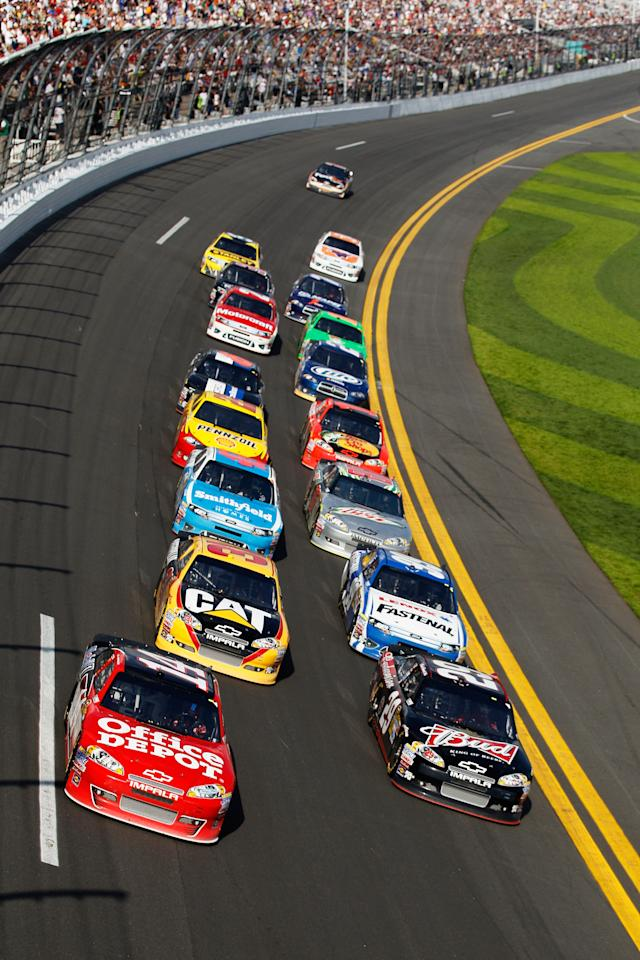 DAYTONA BEACH, FL - FEBRUARY 23:  Tony Stewart, driver of the #14 Office Depot/Mobil 1 Chevrolet, leads a group of cars during the NASCAR Sprint Cup Series Gatorade Duel 1 at Daytona International Speedway on February 23, 2012 in Daytona Beach, Florida.  (Photo by Chris Graythen/Getty Images)