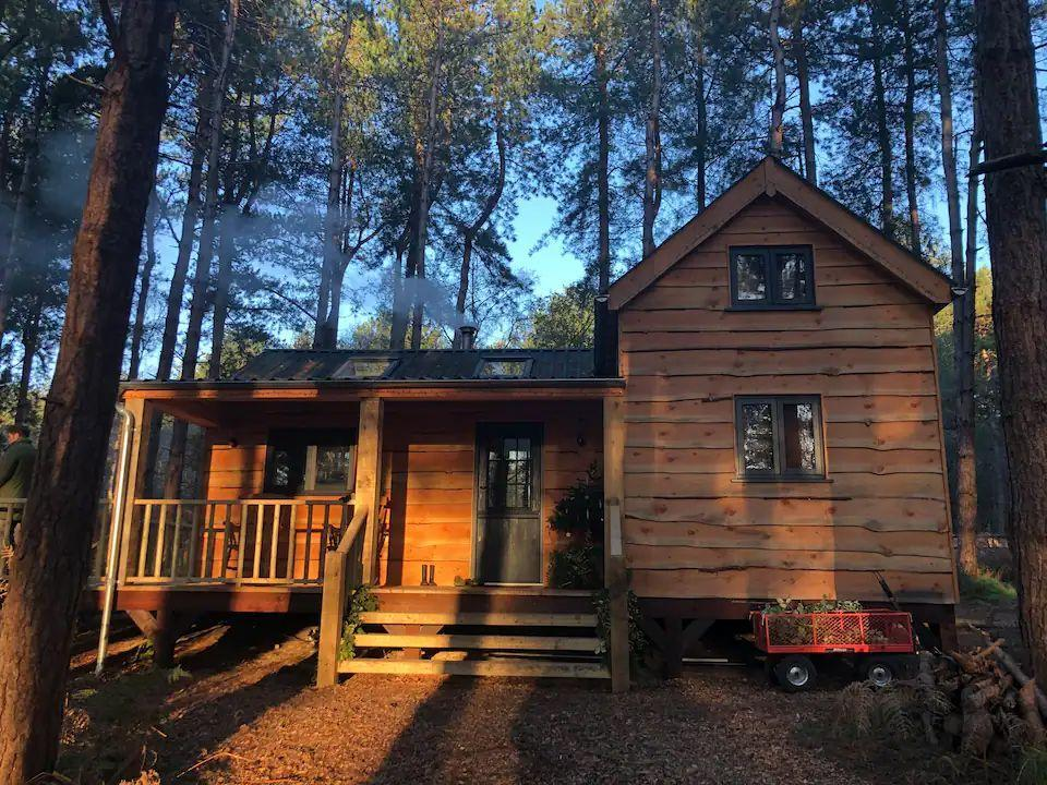 """<p>For a forest hideaway with the home comforts, this Airbnb in Norfolk is worth checking out. Keepers Cabin is a beautifully hand-crafted cabin, with luxuries including a private hot tub, a wood burner and treetop views. It's close to the North Norfolk Coast and there are endless walks in the forest to keep you entertained. From waking up to wildlife to snuggly nights by the fire, this cabin has it all. </p><p><strong>Sleeps: </strong>Four</p><p><a class=""""link rapid-noclick-resp"""" href=""""https://airbnb.pvxt.net/MXB1W2"""" rel=""""nofollow noopener"""" target=""""_blank"""" data-ylk=""""slk:BOOK NOW"""">BOOK NOW</a></p>"""