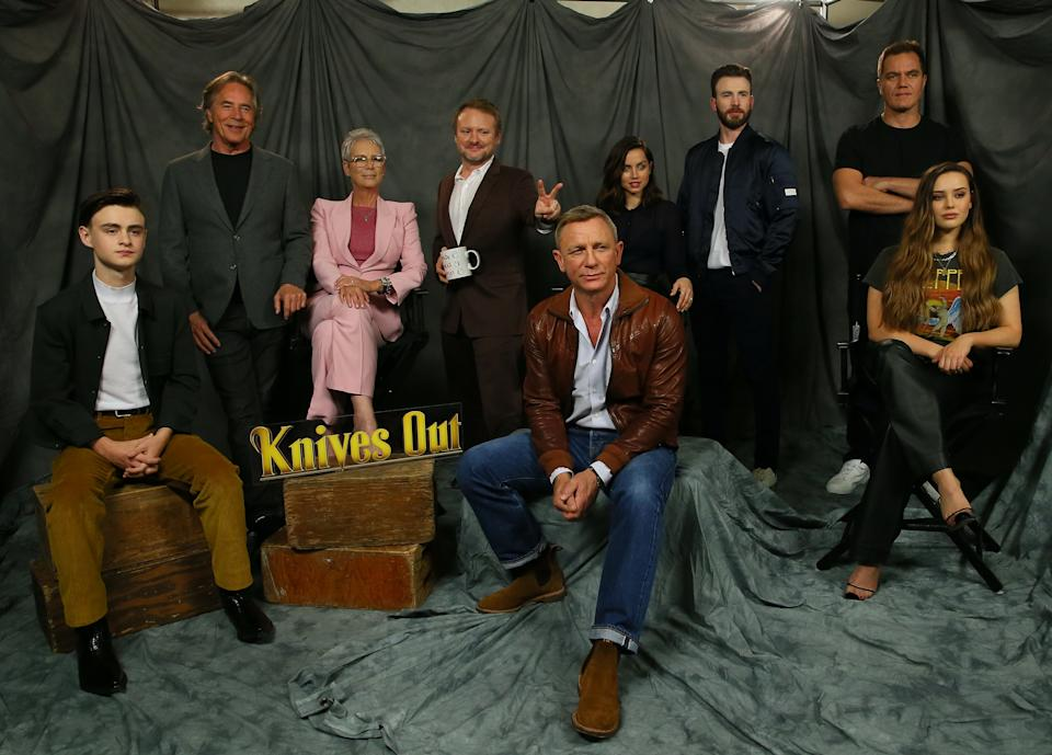 LOS ANGELES, CALIFORNIA - NOVEMBER 15: (L-R) Actors Jaeden Martell, Don Johnson, Jamie Lee Curtis, Rian Johnson, Daniel Craig, Chris Evans, Ana de Armas, Michael Shannon and Katherine Langford attend the photocall for Lionsgate's