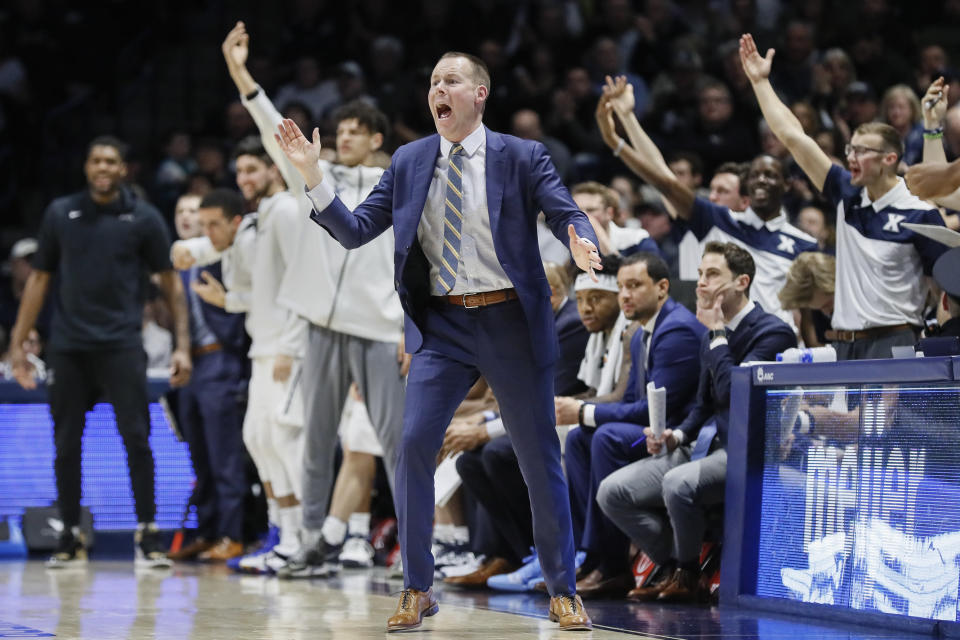 Xavier head coach Travis Steele, center, works the bench in the second half of an NCAA college basketball game against Xavier, Saturday, March 9, 2019, in Cincinnati. (AP Photo/John Minchillo)