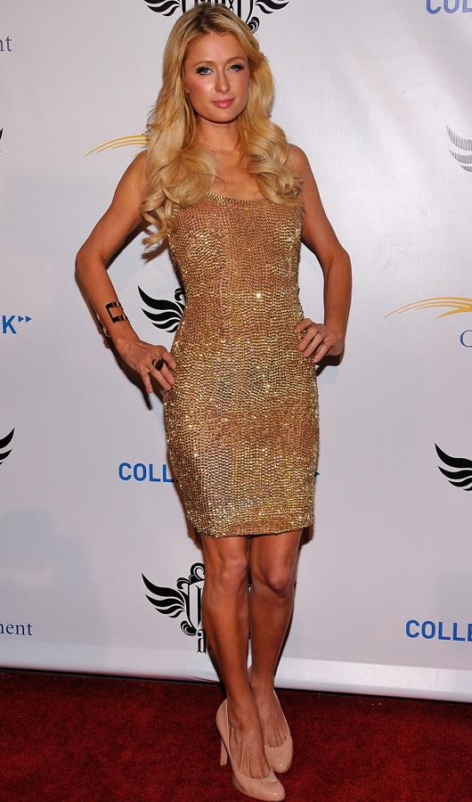 Celebrity fashion gold dresses: Paris Hilton matched her dress to her deep golden tan for a pre Grammy party, doesn't she look amazing?