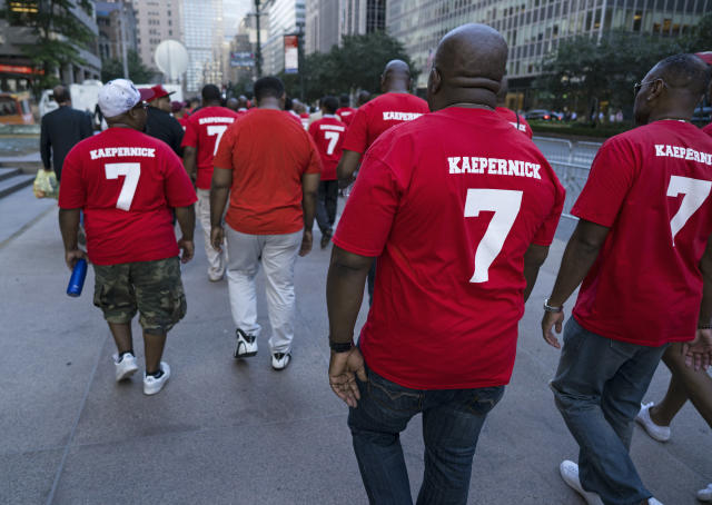 Some of the supporters at the rally for Colin Kaepernick on Wednesday in New York City. (AP)