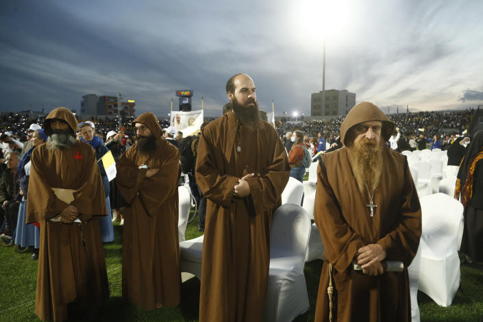 Iraqi Christians say goodbye to Pope Francis after an open air Mass at a stadium in Irbil, Iraq, Sunday, March 7, 2021. (AP Photo/Hadi Mizban)